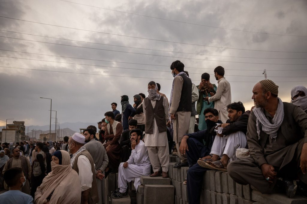 Afghan refugees standing at the Kabul airport